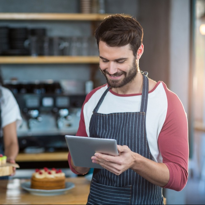 Waiter using tablet at counter